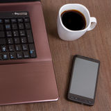 Coffee with laptop and smartphone Royalty Free Stock Photo