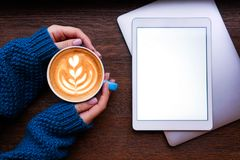 Coffee, laptop and tablet royalty free stock photography