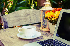 Coffee, laptop on wooden table with flower Royalty Free Stock Photography