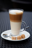 Coffee latte. With brown sugar on the table royalty free stock photos