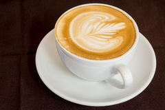 Coffee latte art in coffee shop Royalty Free Stock Image