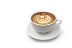 Coffee latte art. Coffee latte with heart shape art isolated on white royalty free stock photos