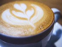 Coffee with Latte art milk foam close up Royalty Free Stock Photos