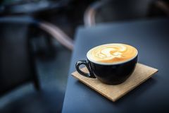 Coffee and latte art on table terrace in restaurant Royalty Free Stock Photo