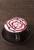A coffee Latte art on teak wood table Stock Images