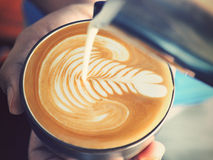Coffee latte art. Vintage color royalty free stock images