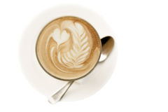 Coffee with latte art on white background Royalty Free Stock Photos