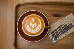 Coffee latte art on the wood tray Stock Images