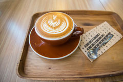 Coffee latte art on the wood tray Royalty Free Stock Photography