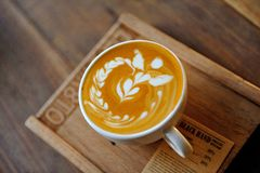 Coffee latte art. Latte art on the wooden board Royalty Free Stock Photography