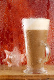 Coffee latte behind rainy window Royalty Free Stock Image