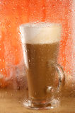 Coffee latte behind rainy window, Stock Photo