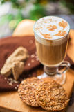 Coffee latte cup with cookies Stock Image