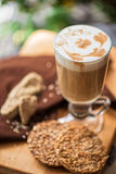 Coffee latte cup with cookies Stock Photos
