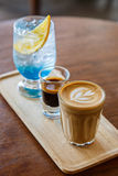 Coffee latte with espresso and blue curacao cocktail on wooden t Royalty Free Stock Photo
