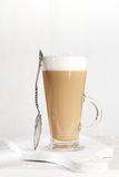 Coffee latte with frothy milk in tall glass Royalty Free Stock Images