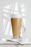 Coffee latte with frothy milk in tall glass Stock Images