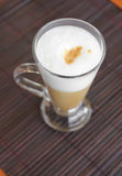 Coffee latte with frothy milk in tall glass. Royalty Free Stock Photo