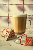 Coffee Latte with gift boxes, envelope and paper hearts. Pink, red, white colors on bright background. Love, Valentine`s Stock Images