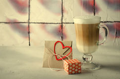 Coffee Latte with gift boxes, envelope and paper hearts. Pink, red, white colors on bright background. Love, Valentine`s Royalty Free Stock Image