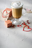 Coffee Latte with gift boxes, envelope and paper hearts. Pink, red, white colors on bright background. Love, Valentine`s Stock Image