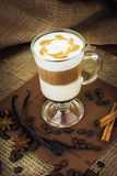 Coffee latte in glass cup. A wooden background Stock Images