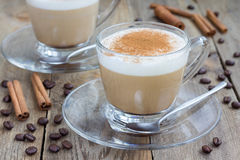 Coffee latte in glass cups. On a wooden table Stock Images