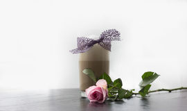 Coffee Latte Glass with Purple Lace and Pink Rose. On Black Table Royalty Free Stock Image