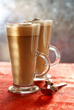 Coffee Latte on glitter backdrop with sunny light Stock Photography