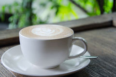 Coffee latte on grained wood table outdoor Stock Photography