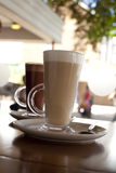 Coffee latte and hot chocolate in tall glasses royalty free stock photography