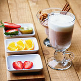 Coffee latte, ice scream and sliced fruits Royalty Free Stock Photography