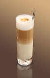 Coffee latte macchiato. Coffee in a glass on gradient background Stock Photography