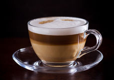 Coffee latte macchiato on a black background Stock Photo