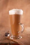 Coffee latte macchiato with cream in glass Stock Photos