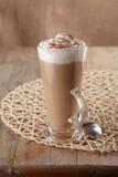 Coffee latte macchiato with cream in glass stock photography