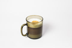 Coffee Latte Macchiato. Puff coffee of Latte Macchiato in a black mug Royalty Free Stock Photo