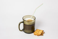 Coffee Latte Macchiato. Puff coffee of Latte Macchiato in a black mug Stock Photos
