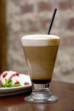 Coffee latte macchinato. With dessert Royalty Free Stock Image