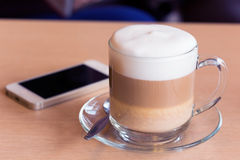 Coffee latte with milk froth Royalty Free Stock Photo