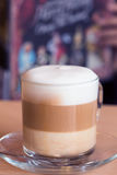 Coffee latte with milk froth Stock Images