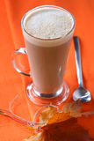 Coffee latte in orange fall autumn style. Shallow DOF stock image