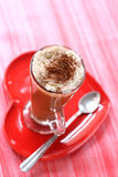 Coffee latte on red heart plate Royalty Free Stock Photography