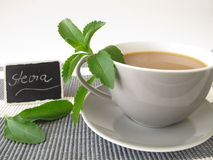 Coffee latte with stevia and nameplate. Cup of Café au lait with stevia and nameplate Stock Image
