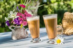 Coffee latte in a sunny garden Royalty Free Stock Photo