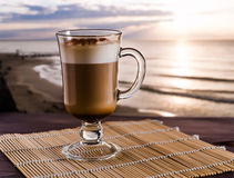 Coffee latte. On the sunrise background, selective focus Stock Image