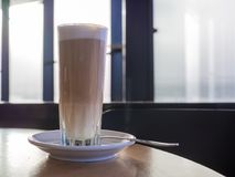 Coffee latte in tall glass Royalty Free Stock Photos