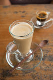 Coffee latte in tall glass with wooden spoon Royalty Free Stock Images