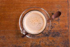 Coffee latte in tall glass with wooden spoon Stock Photography