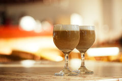 Coffee latte in tall glasses with morning sun in summer cafe bac Royalty Free Stock Image